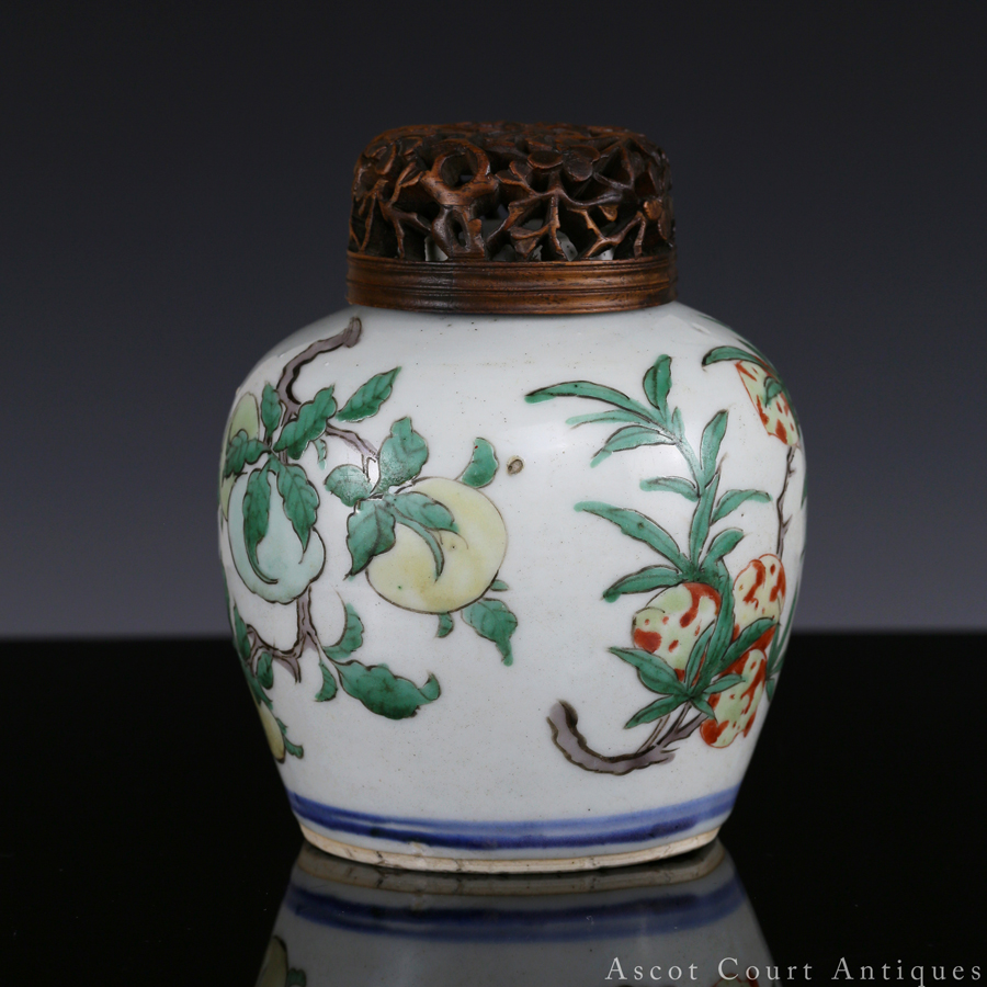 Transitional Shunzhi Wucai Jar with Peaches and Pomegranates 清顺治 五彩桃榴二果小罐